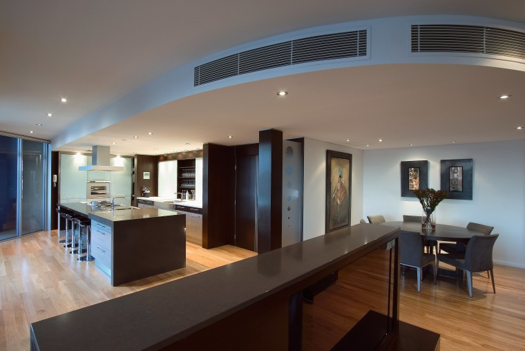 view of the kitchen featuring darkwood veneer wall, apartment, ceiling, estate, floor, interior design, real estate, gray