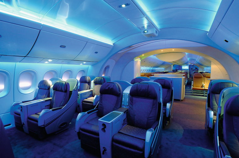 A view of the cabin area. aerospace engineering, air travel, aircraft, aircraft cabin, airline, airplane, aviation, blue, interior design, mode of transport, passenger, blue, teal