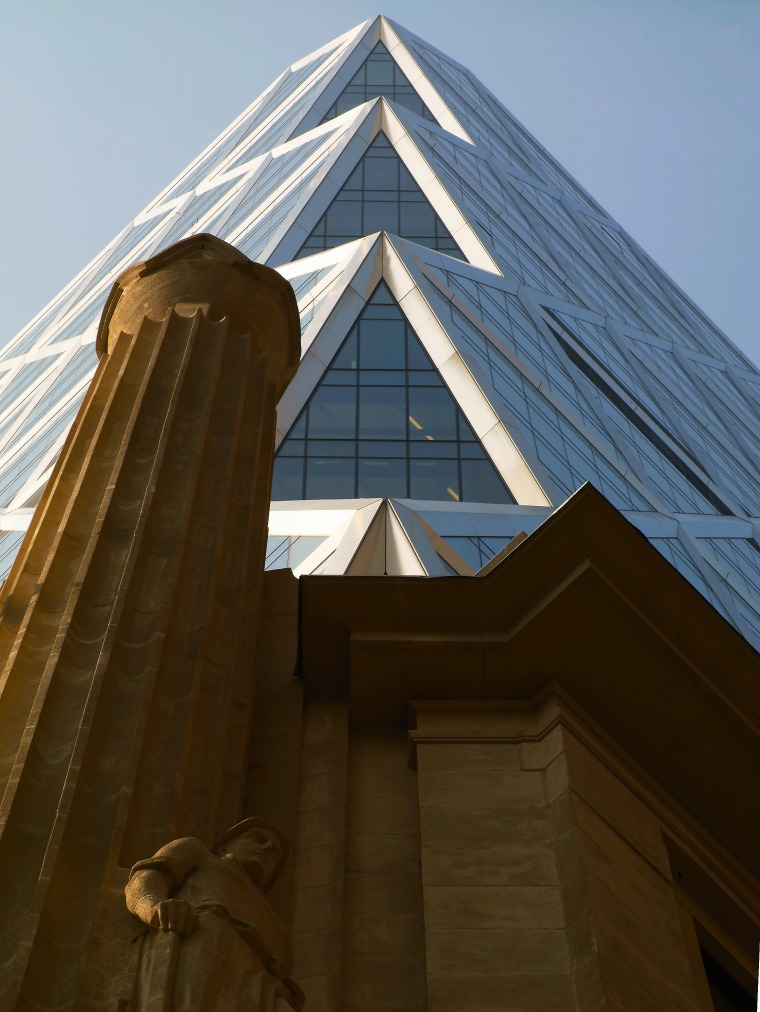 view of the exterior of this hi-rise building angle, architecture, building, daylighting, daytime, facade, landmark, roof, sky, skyscraper, structure, symmetry, wood, brown