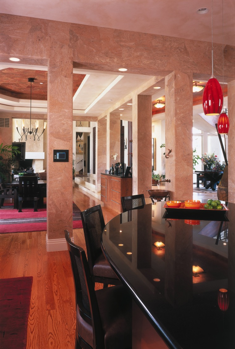 A view of the kitchen and dining areas. ceiling, dining room, floor, flooring, furniture, interior design, lobby, restaurant, room, table, red, black