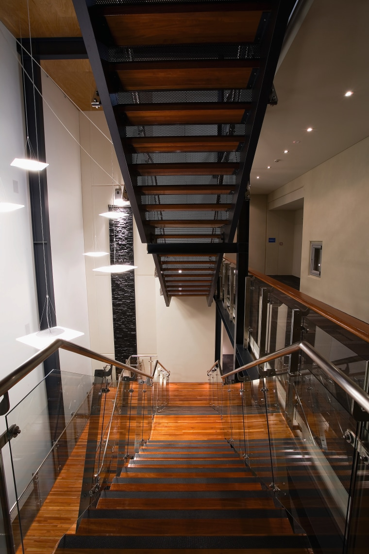 A view of the Trends Building. apartment, architecture, ceiling, daylighting, handrail, interior design, stairs, wood, black, brown
