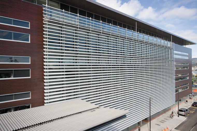 A view of the louvres. architecture, building, commercial building, corporate headquarters, daylighting, facade, headquarters, house, line, metropolitan area, real estate, residential area, roof, siding, structure, window, window covering, gray, black, white