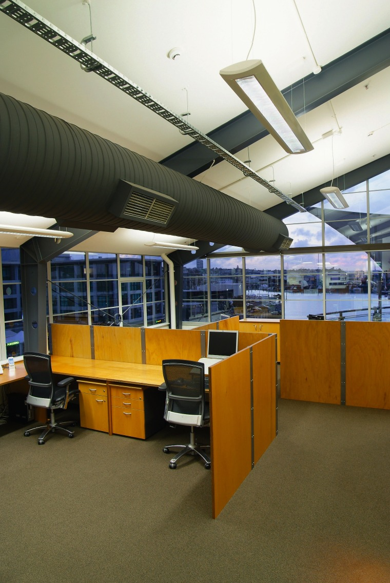 A view of an office by Hawkins Interiors. architecture, ceiling, daylighting, institution, interior design, office, brown