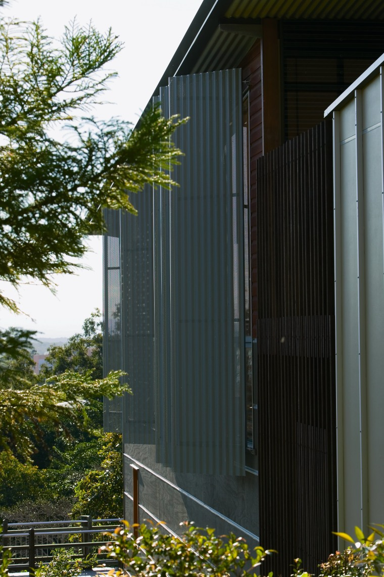 view of the shutterflex currgated screens on the architecture, building, facade, home, house, real estate, residential area, shed, siding, window, black
