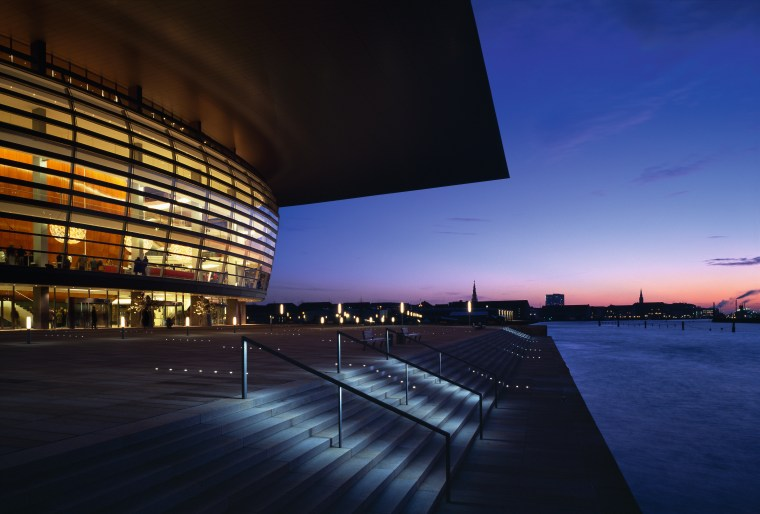 An exteior view of the building. architecture, atmosphere, building, city, cityscape, convention center, corporate headquarters, dawn, dusk, evening, headquarters, horizon, landmark, metropolis, metropolitan area, night, opera house, performing arts center, reflection, sky, structure, sunlight, sunset, water, blue, black