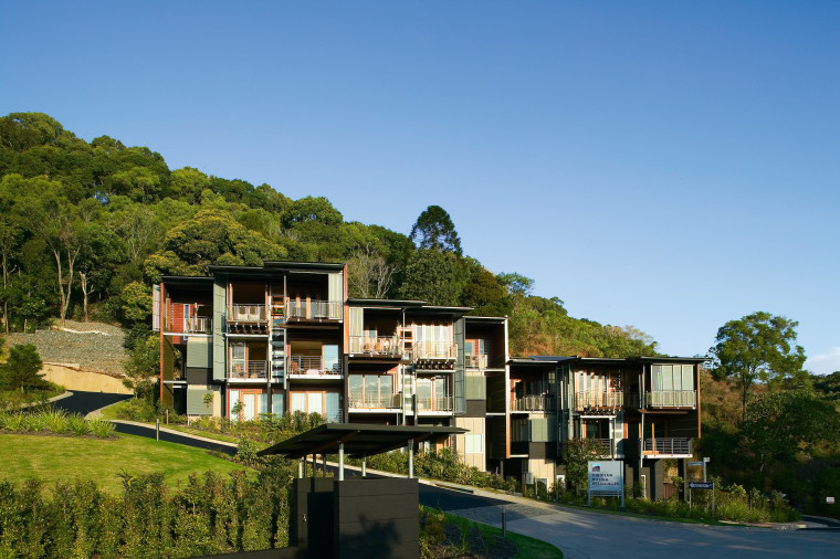 Exterior view of this new apartment block  architecture, building, condominium, cottage, estate, home, house, plant, property, real estate, residential area, sky, tree, villa, teal, brown