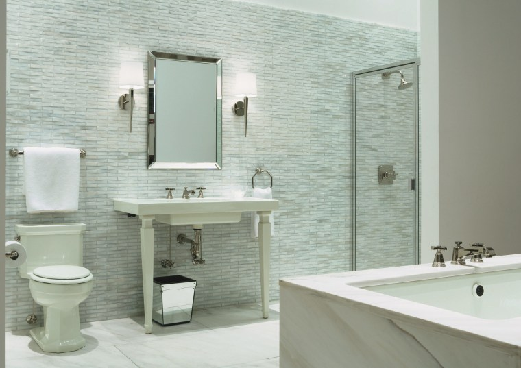 view of the new Kohler Chicago store showcasing bathroom, bathroom accessory, bathroom cabinet, bathroom sink, ceramic, floor, interior design, plumbing fixture, product design, room, sink, tap, tile, wall, gray