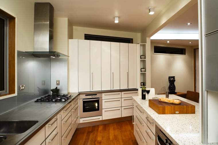 A view of the kitchen area, wooden flooring cabinetry, countertop, cuisine classique, interior design, kitchen, real estate, room, white, brown