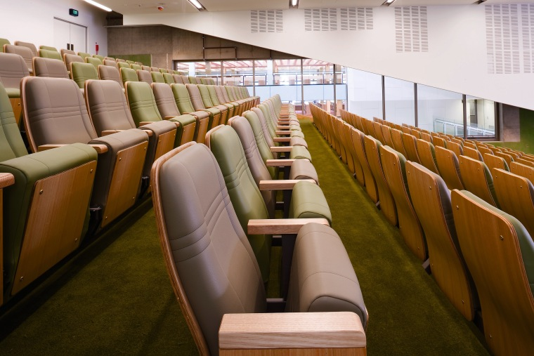 A view of some seating by Fagaleo Pty auditorium, conference hall, furniture, brown, white