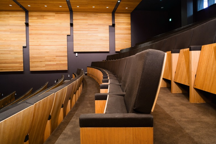 A view of some seating from Civic Seating architecture, auditorium, flooring, furniture, interior design, lobby, wood, brown, orange, black