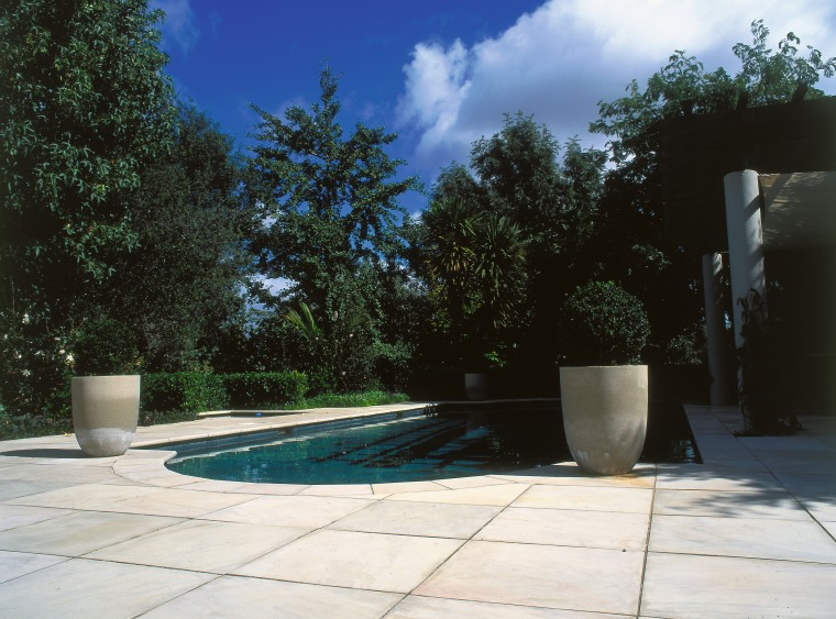 A view of some paving from Original Stone. architecture, backyard, estate, home, house, landscape, landscaping, outdoor structure, plant, property, real estate, residential area, swimming pool, tree, wall, yard, black, white