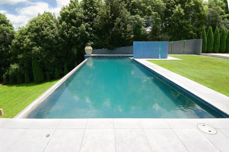A view of a swimming pool from Pleasure backyard, daylighting, grass, house, lawn, leisure, property, real estate, swimming pool, yard, white