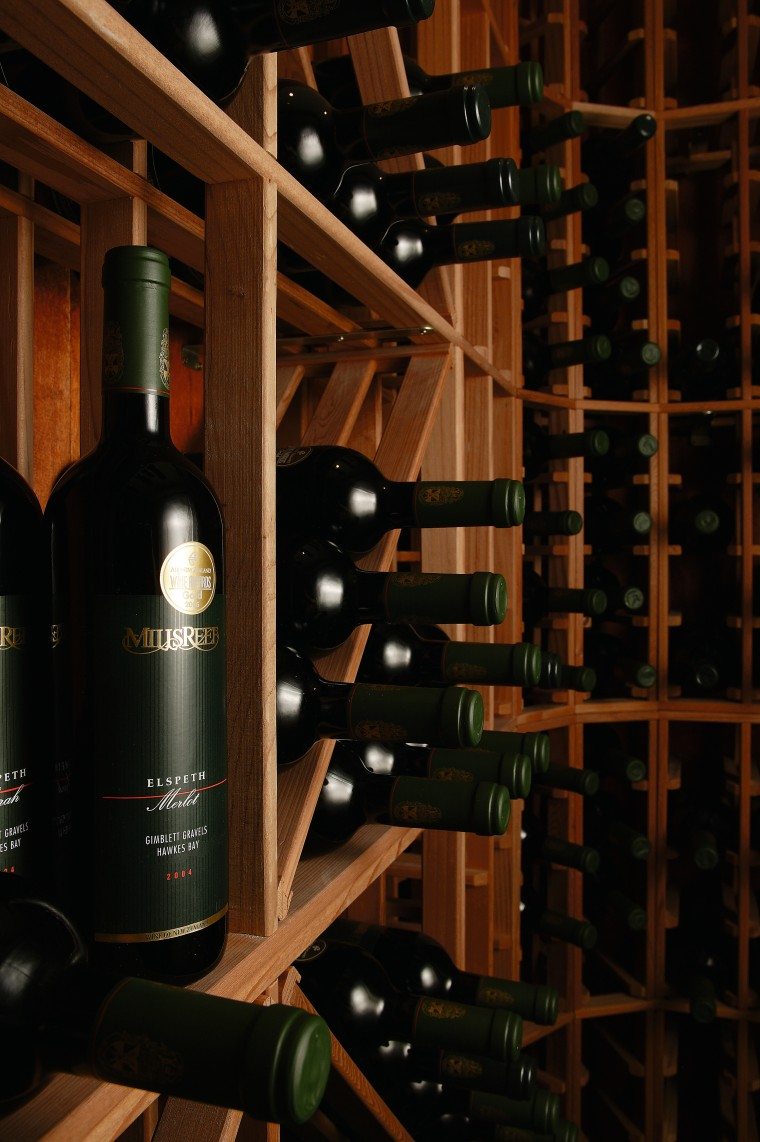 A view of a wine cellar by Baywick's alcoholic beverage, bottle, distilled beverage, drink, glass bottle, liquor store, wine, wine cellar, winery, wood, black, brown