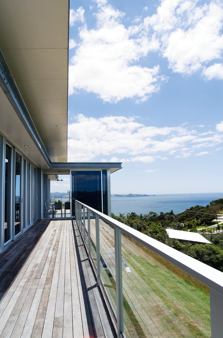 A view of some glass balustrades from Unex architecture, building, home, house, property, real estate, sky, white