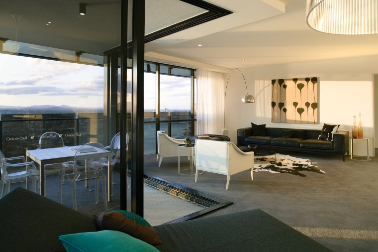 A view of the interior living spaces of architecture, house, interior design, living room, penthouse apartment, real estate, room, window, black