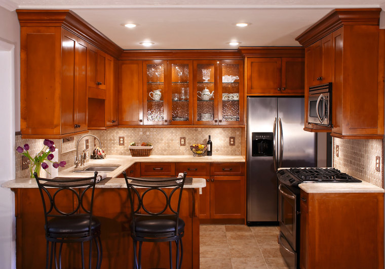 A view of this kitchen featuring solid maple cabinetry, countertop, cuisine classique, interior design, kitchen, real estate, room, brown
