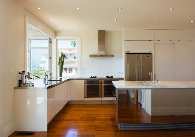 Minimal in it's aesthetic, this kitchen maximies impact cabinetry, ceiling, countertop, floor, flooring, hardwood, interior design, kitchen, property, real estate, room, wood flooring, orange, brown