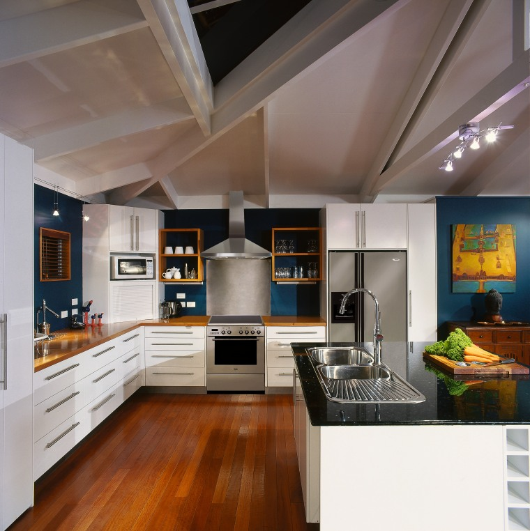 A view of some kitchen appliances by Whirlpool. countertop, interior design, kitchen, real estate, gray, brown