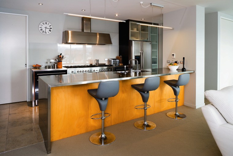 A veiw of this kitchen featuring stainless steel countertop, furniture, interior design, kitchen, product design, real estate, room, table, gray, brown