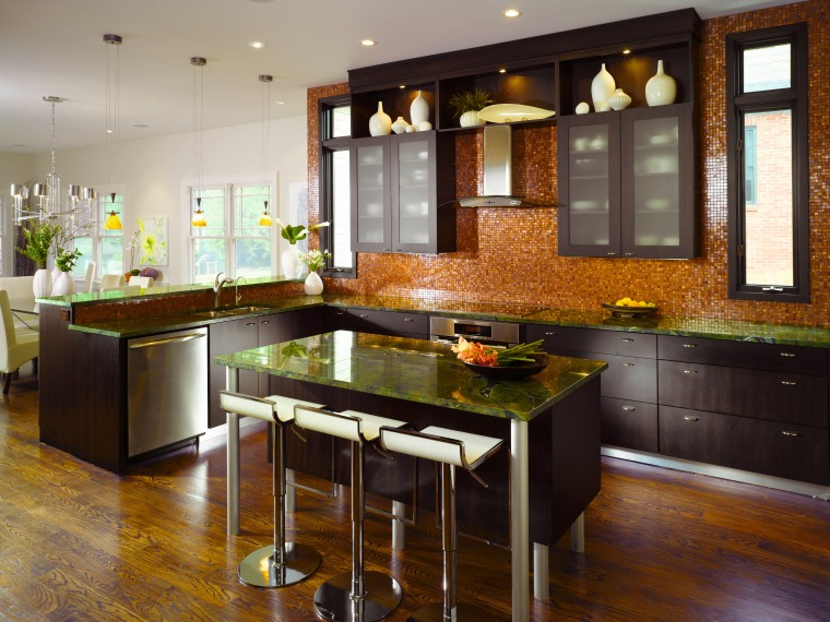 Kitchen designer Shadawn Zareh has kept the island cabinetry, countertop, cuisine classique, floor, flooring, hardwood, interior design, kitchen, room, wood flooring, brown, gray, black