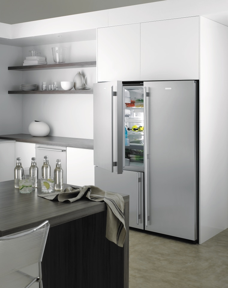 A view of this kitchen featuring a refrigerator home appliance, kitchen, kitchen appliance, major appliance, product design, refrigerator, small appliance, gray, white