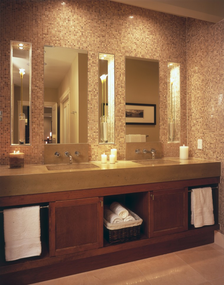 A view of the maser bathroom featuring tiled bathroom, bathroom accessory, bathroom cabinet, cabinetry, flooring, furniture, interior design, room, sink, wall, orange, brown