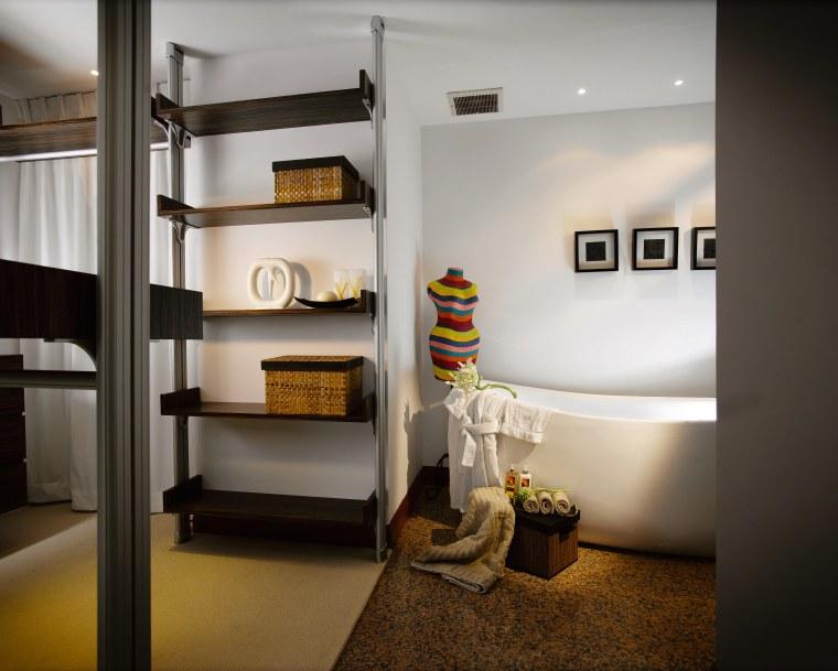 A view of the master bedroom. ceiling, furniture, home, interior design, room, shelf, shelving, gray, black