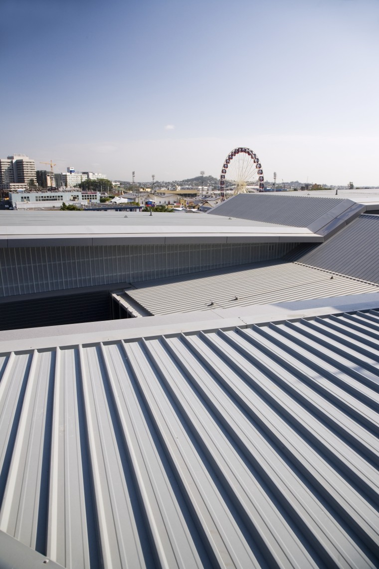 A view of the metal roofing and fibreglass architecture, building, daylighting, daytime, fixed link, line, outdoor structure, roof, sky, structure, water, white, gray