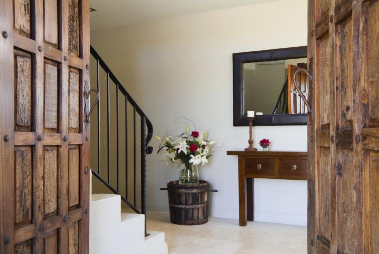 The modern, European rustic look is reinforced by door, estate, floor, flooring, furniture, home, interior design, property, real estate, room, wood, brown, gray