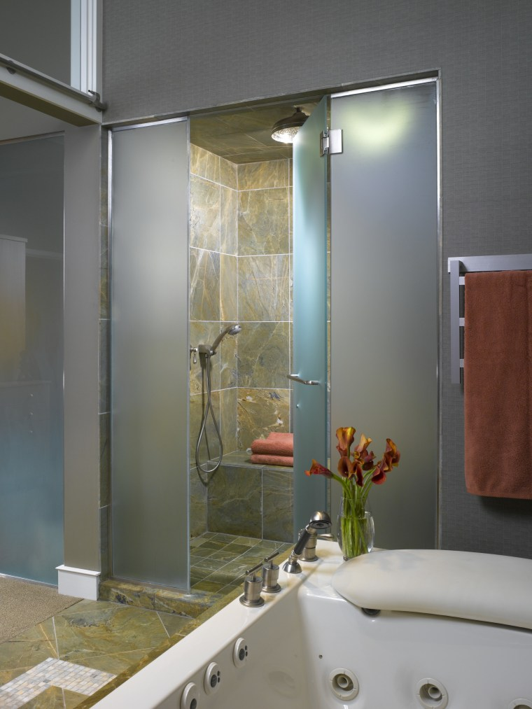 A view of this bathroom featuring a pearwood bathroom, glass, interior design, plumbing fixture, room, window, gray