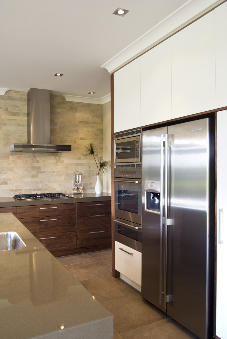 A view of some kitchen appliances from Electorlux. cabinetry, countertop, cuisine classique, home appliance, interior design, kitchen, major appliance, real estate, refrigerator, room, brown, gray