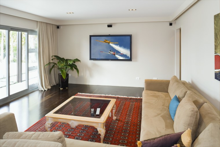 The home theatre includes a 65inch plasma display interior design, living room, property, real estate, room, suite, gray, white
