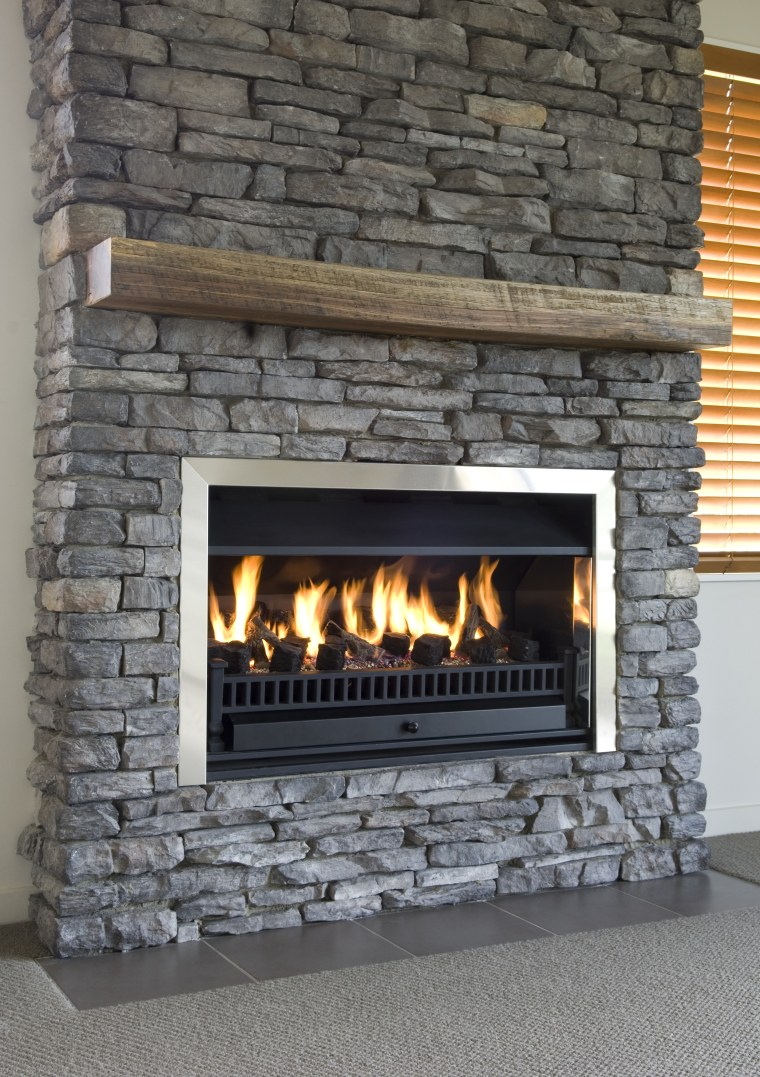 A view of a stone fireplace from Stutex fireplace, hearth, heat, masonry oven, wood burning stove, gray, black