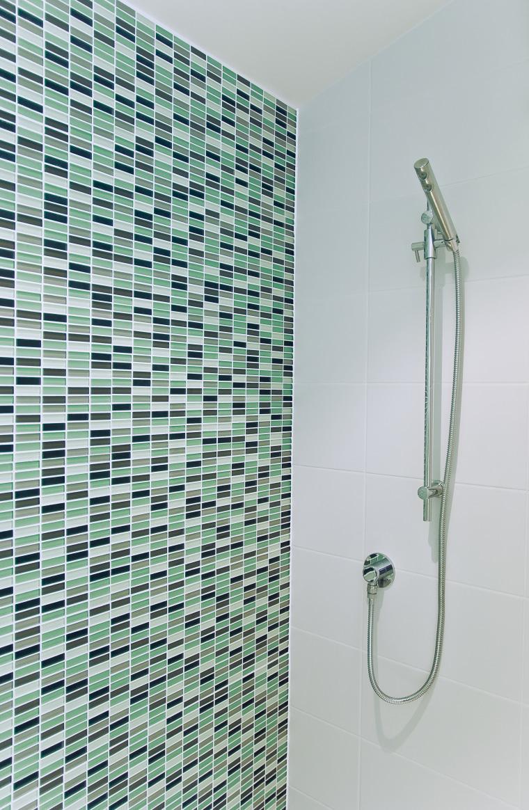 The Edra shower follows clean,minimalist lines. bathroom, floor, glass, plumbing fixture, product design, shower, tile, gray