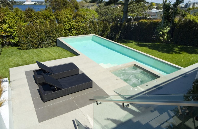 A view of a swimming pool by Mayfair backyard, daylighting, leisure, outdoor furniture, property, roof, sunlounger, swimming pool, water