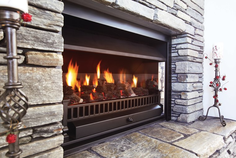 A view of a fireplace from Real Fires. fire screen, fireplace, hearth, heat, wood burning stove, gray, black