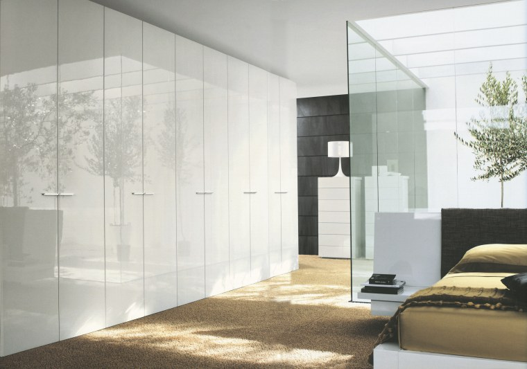 A view of a storage space designed by architecture, door, floor, furniture, glass, interior design, wall, wardrobe, white