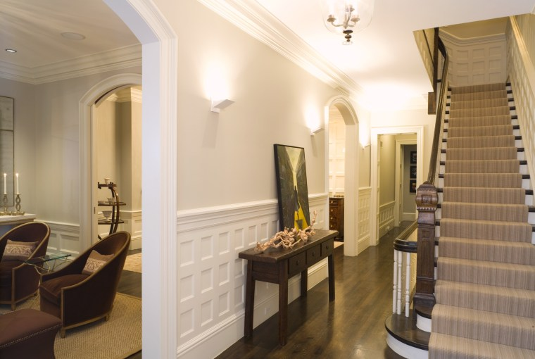 view of stairway featuring white walls, carpeted stairs, ceiling, estate, flooring, interior design, lobby, property, real estate, room, suite, brown, white, orange