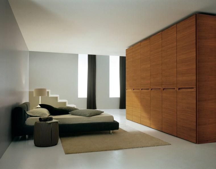 View of wardrobe system by Prestige Designs. bed frame, bedroom, floor, furniture, interior design, product design, room, wardrobe, wood, gray, brown