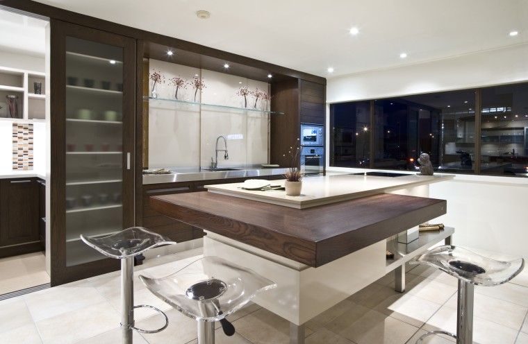 A dsitinctive, mixed material palette features in this cabinetry, countertop, cuisine classique, interior design, kitchen, white