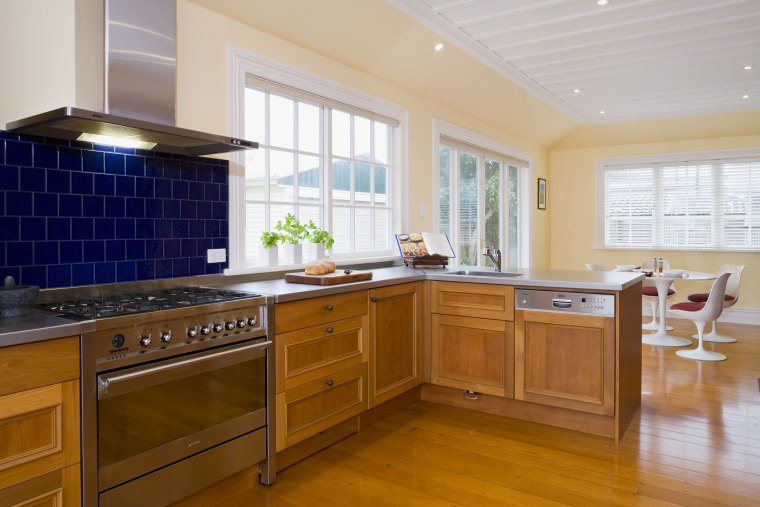 view of a renovated kitchen where Swamp kauri cabinetry, countertop, cuisine classique, floor, flooring, hardwood, home, interior design, kitchen, property, real estate, room, window, brown, gray