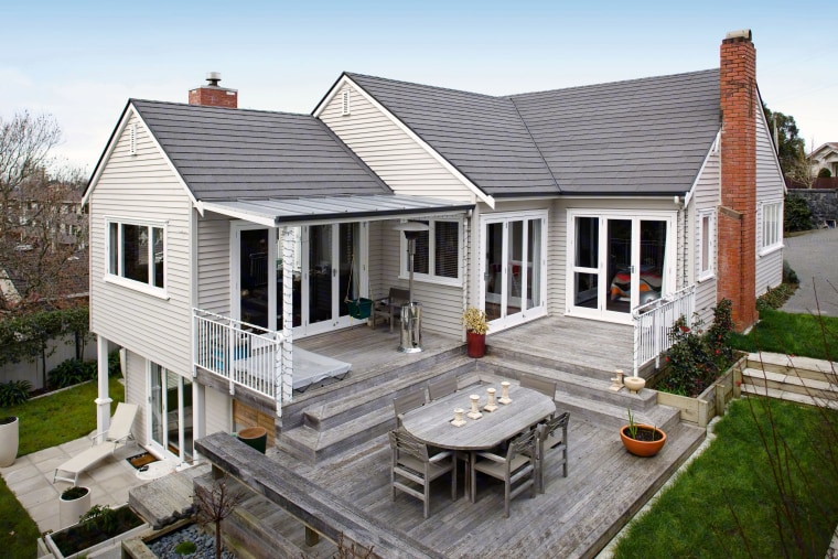Have an older home? New shingles may be backyard, cottage, elevation, estate, facade, farmhouse, home, house, outdoor structure, porch, property, real estate, residential area, roof, siding, white, gray