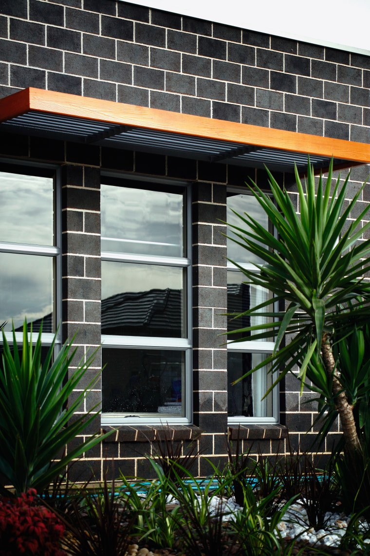 Brick has been used a building material or facade, house, window, black