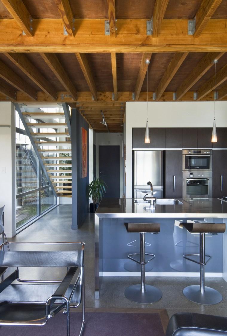 View of kitchen with stainless steel kitchen island, architecture, beam, ceiling, countertop, daylighting, house, interior design, kitchen, loft