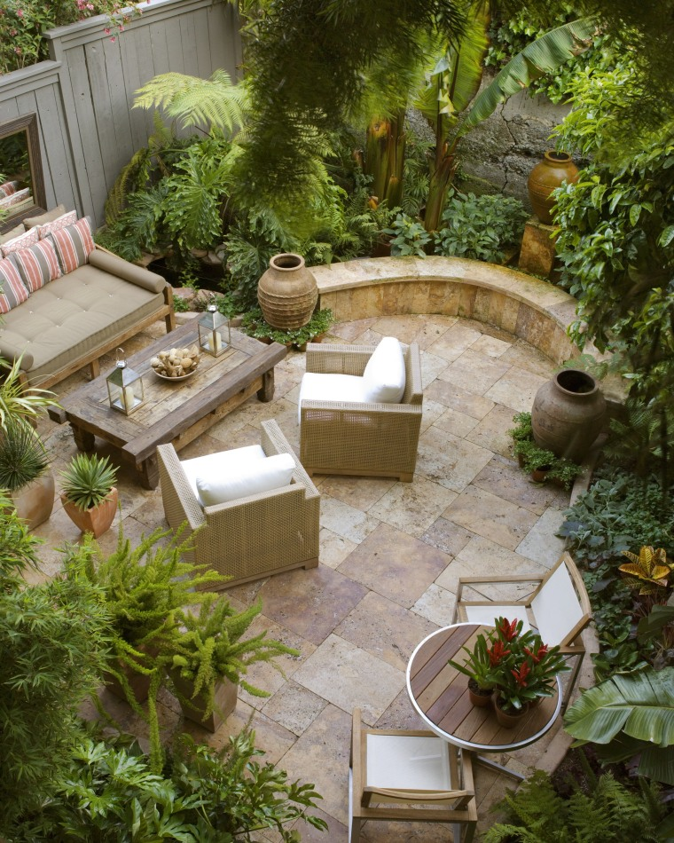 View of a small shaded garden which features backyard, courtyard, furniture, garden, landscaping, outdoor structure, patio, table, yard, brown