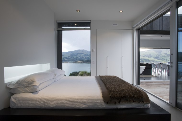 view of bedroom which features glass sliding doors, bedroom, interior design, room, suite, window, gray
