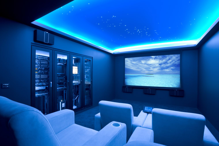 View of home cinema with projector screen, audiovisual blue, ceiling, display device, interior design, lighting, room, technology, blue