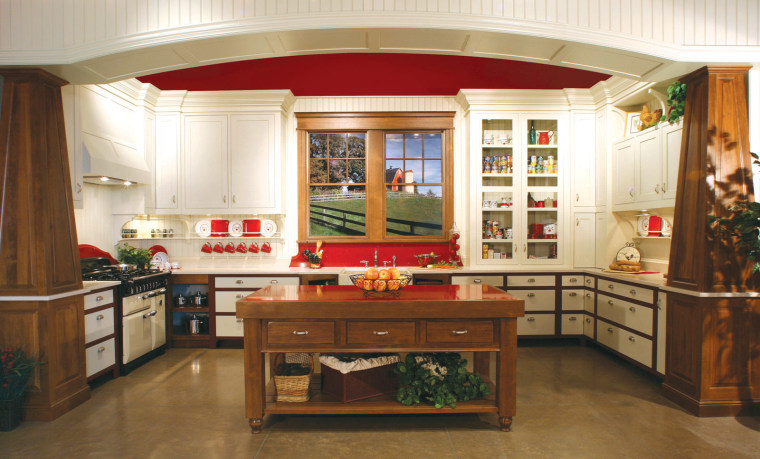 View of a country kitchen which features cabinetry cabinetry, countertop, cuisine classique, furniture, interior design, kitchen, room, brown, white