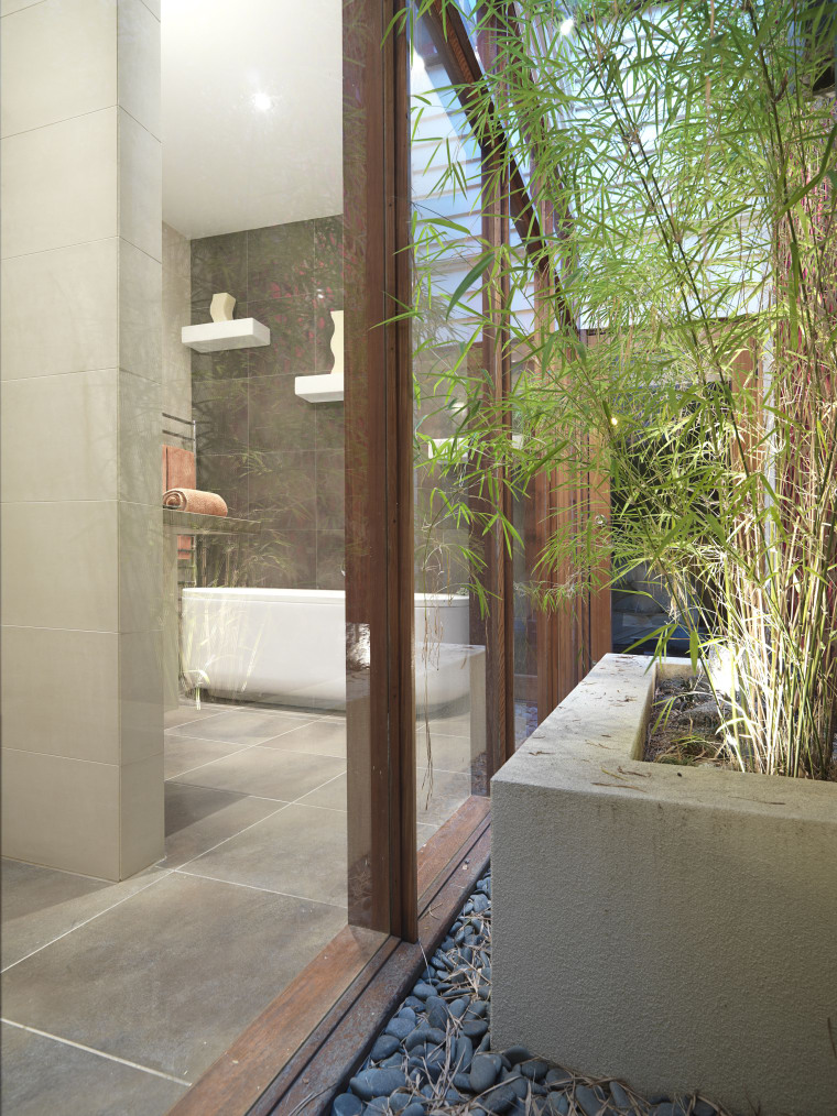 View of renovated bathroom, featuring bathtub, ceramic tiled architecture, door, glass, home, house, interior design, property, real estate, window, gray, brown