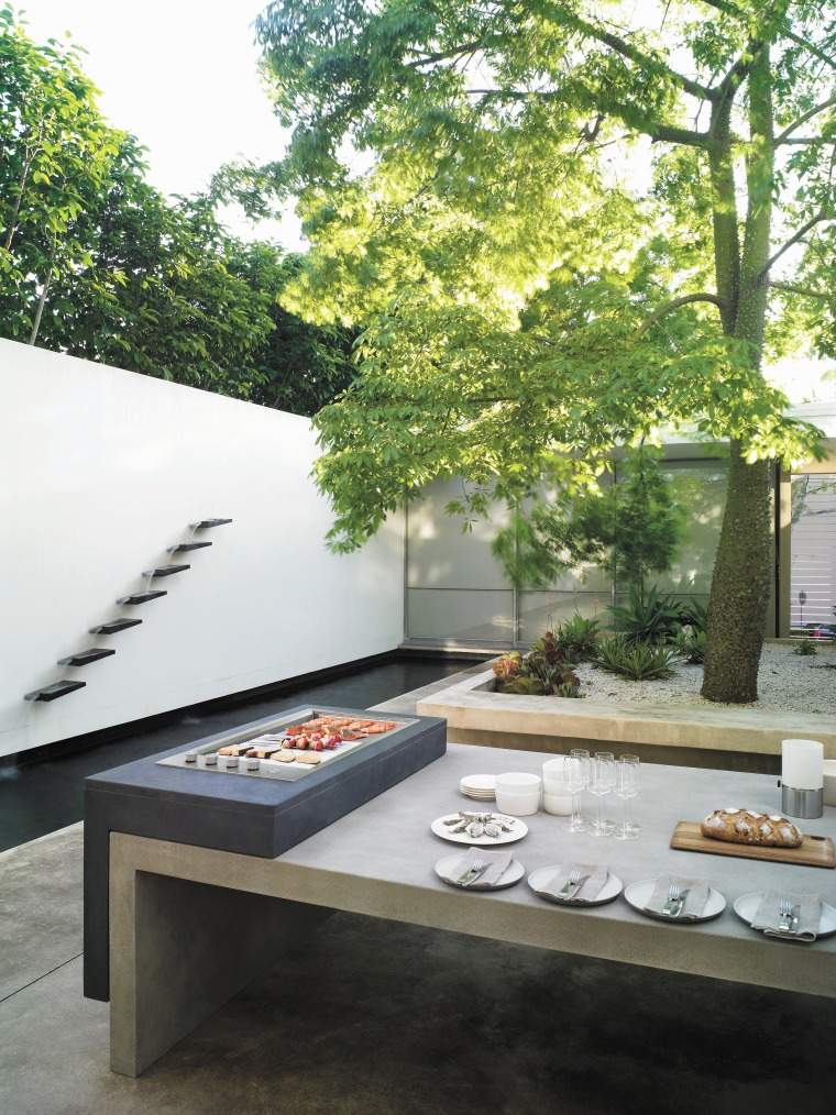 View of outdoor area which features outdoor cooking architecture, courtyard, furniture, home, house, table, white